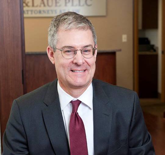 ROBERT P. LAUE